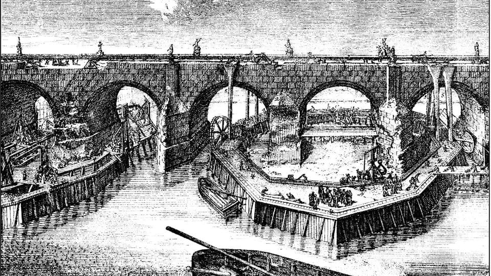 La reconstruction du pont Charles après la inondation en 1784,  source: public domain